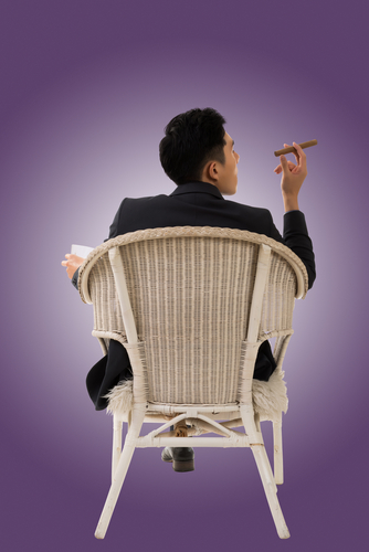 Cunning Businessman smoking a cigar